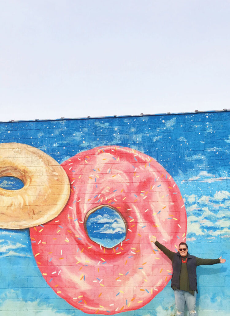 Hannah in front of the doughnut mural in Chattanooga