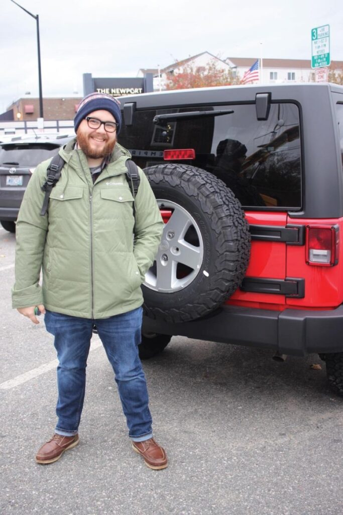 Brandon with a red Jeep
