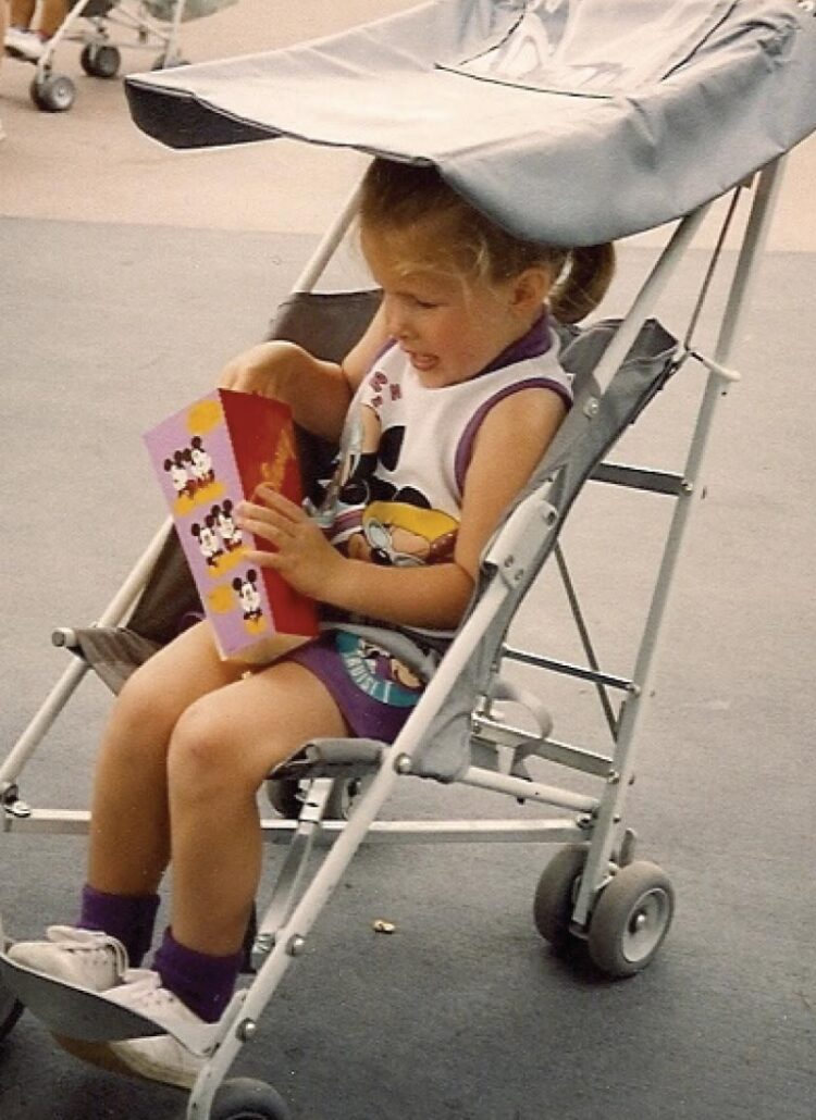 Hannah, age 3, with popcorn at Disney World