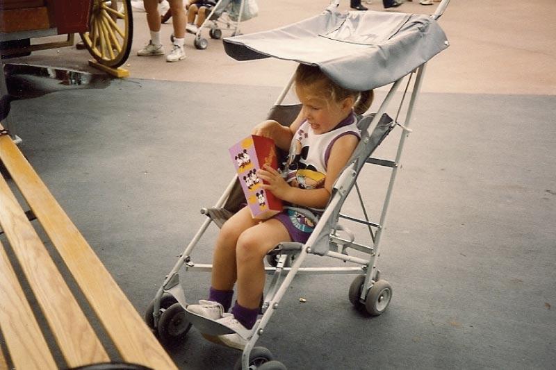 Hannah, age 3, with popcorn at Disney World